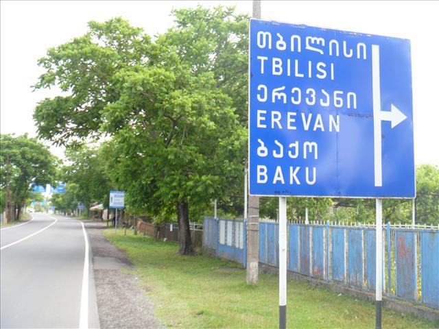 A street sign: Tbilisi. Erevan, Baku turn right