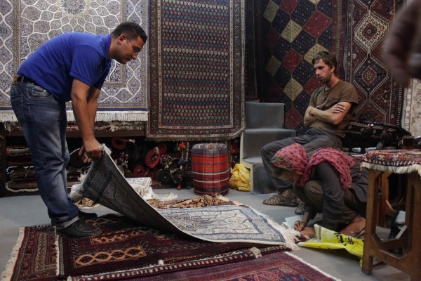 Ehsan, the salesman, showing us the different types of Carpets