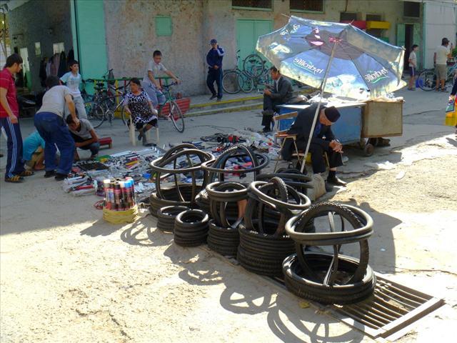Bicycle part shopping in the Chorsu Bazaar in Tashkent