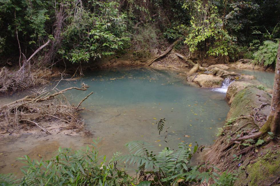 Kuang Si Falls lagoon, blue water.