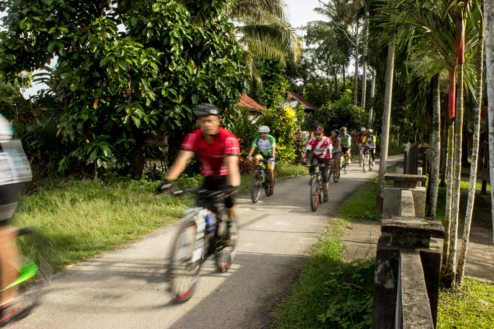 Passing through the Kampung (Village) by Bike