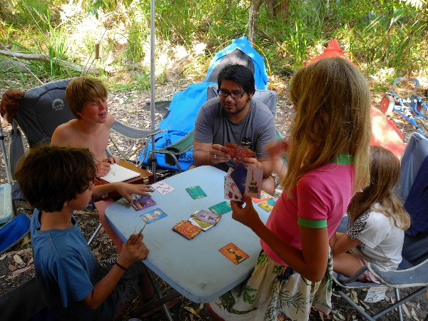 Roberto playing card games with the kids
