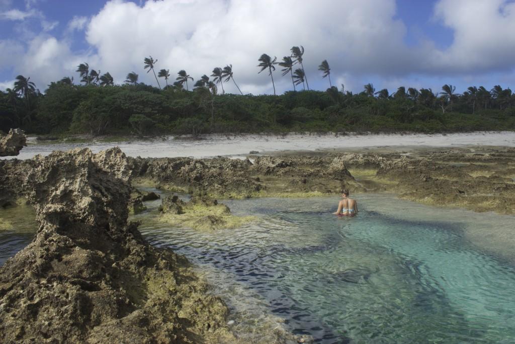 Our little perfect swimming lagoon full of tiny blue fishes in Haaluma beach, 'Eua, Tonga