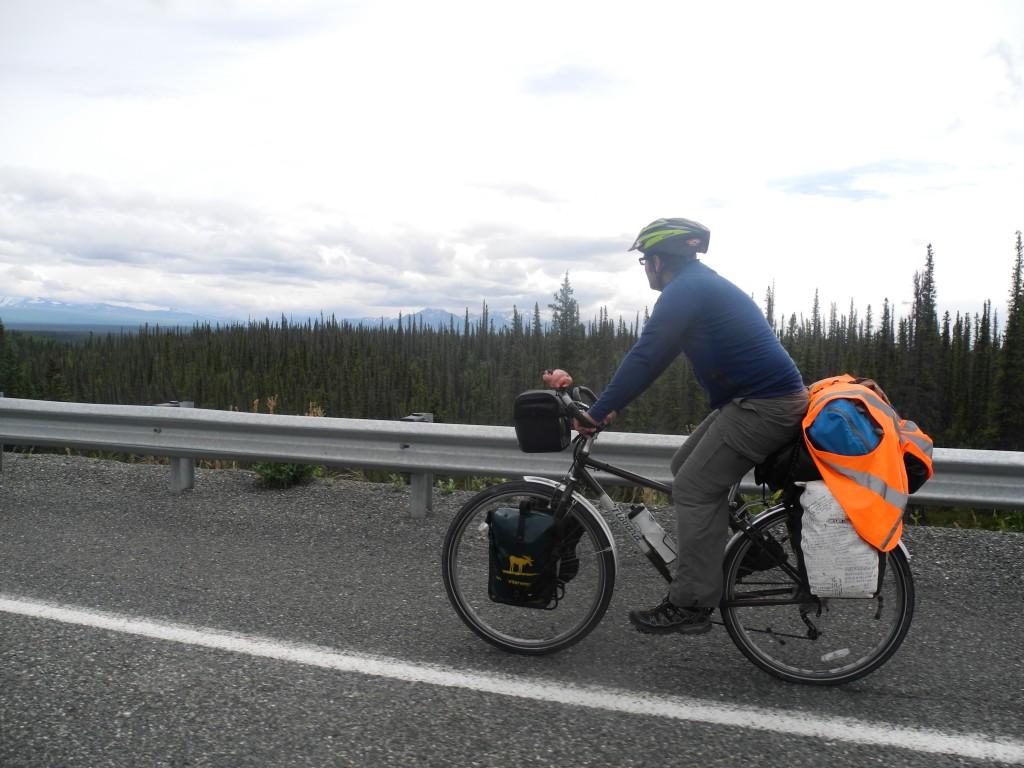 Roberto cycling the Tok Cutoff