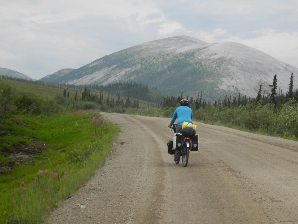 Roberto rides towards the mountains