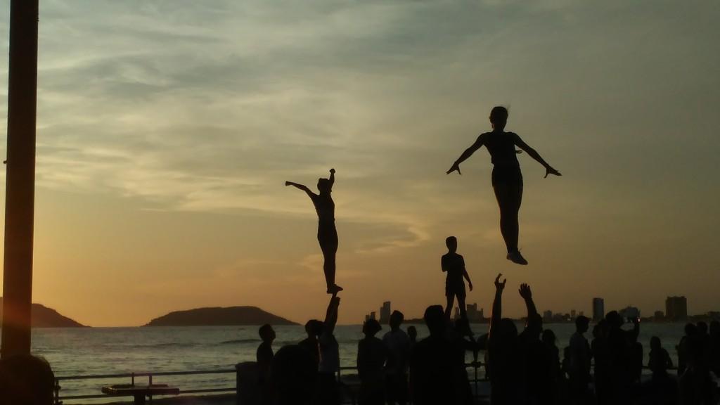 Cheerleading outdoors at sunset