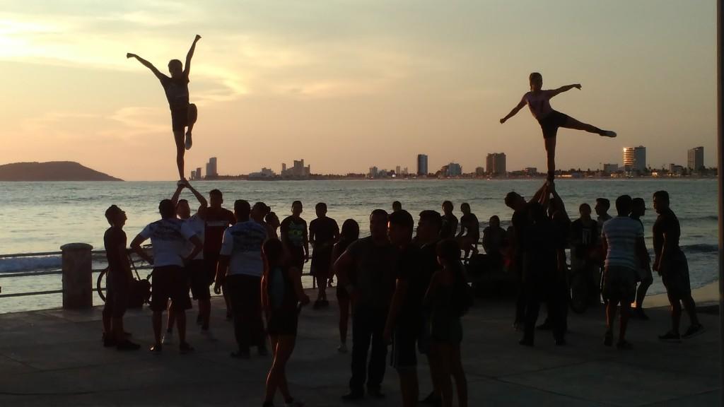 Cheerleader's training outdoors at sunset