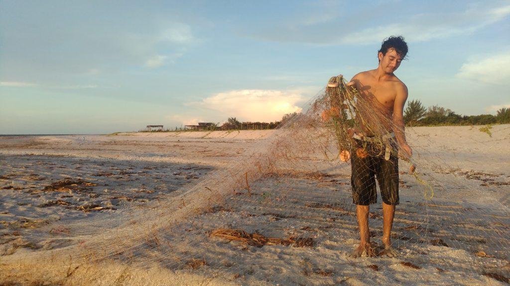 Fisherman on the beach of Isla Aguada