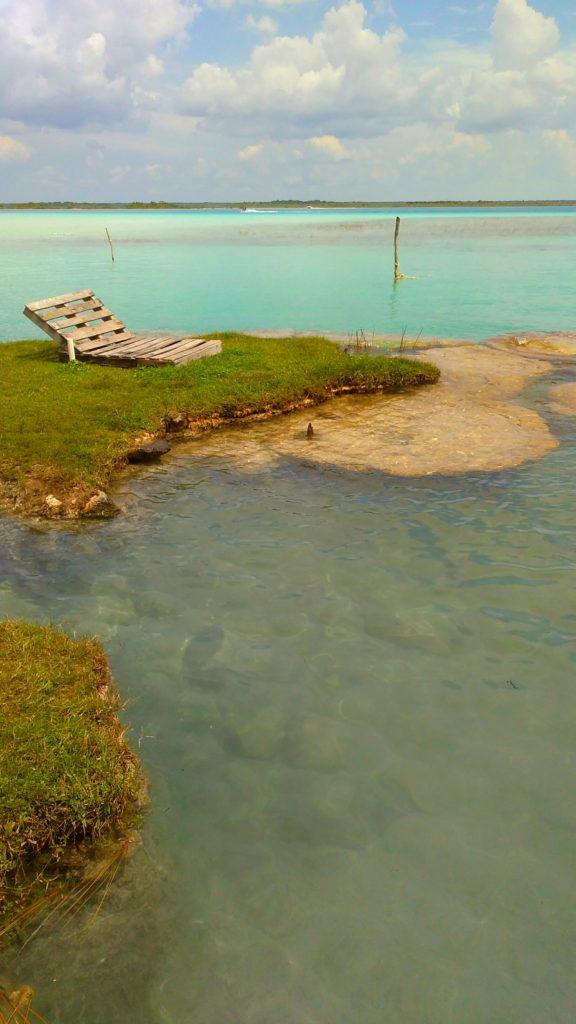 Relaxing beach chair view inside the laguna of Bacalar