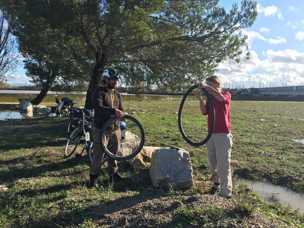 Roberto and Annika fixing a flat tire